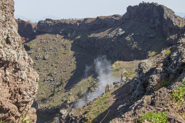 A fumerole smoking inside the crater of Mount Vesuvius in Italy