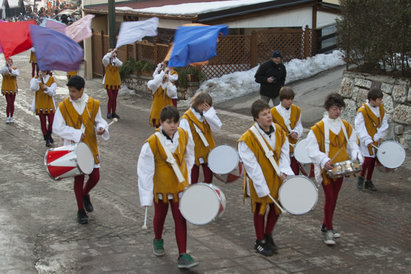 A parade through the streets of Folgaria in the Dolomites
