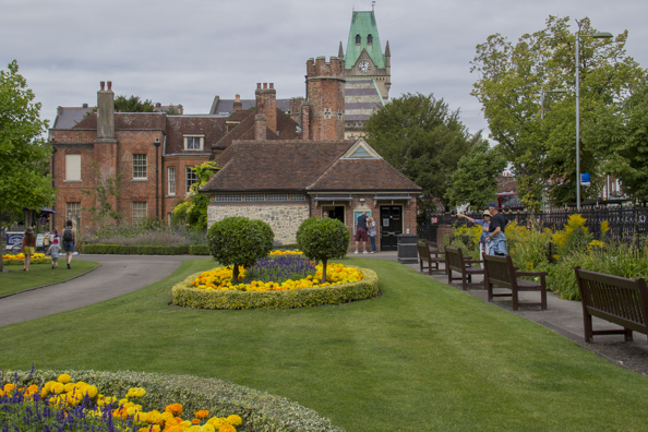 Abbey Gardens with the clock on the Guild Hall of  Winchester in the background-