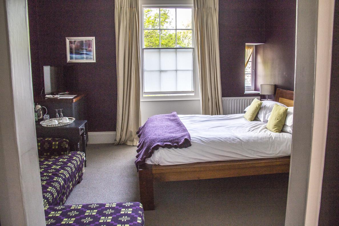 50de77da31cd A bedroom at Llys Meddyg in Newport