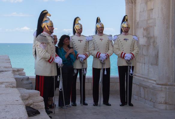A very elegant wedding party outside the cathedral of Trani in Puglia