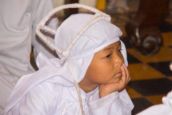 A young member of the Cao Dai Temple at Tay Ninh in Vietnam