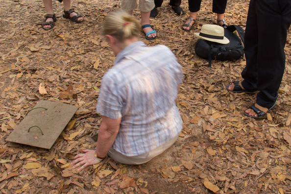 Attempting to enter a tunnel in the complex at Cu Chi in Vietnam