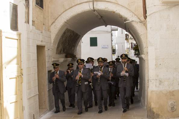 Band marching through the historic centre of Monopoli, Puglia in Italy