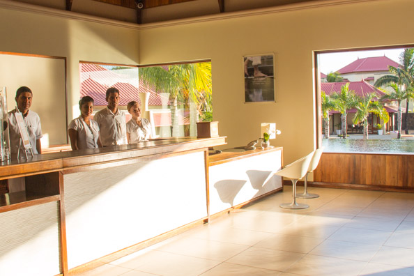 Benoit, Rooms Manager, with his staff in reception at the Tamassa hotel, Bel Ombre on Mauritius