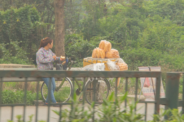 Bread seller by the roadside in Vietnam