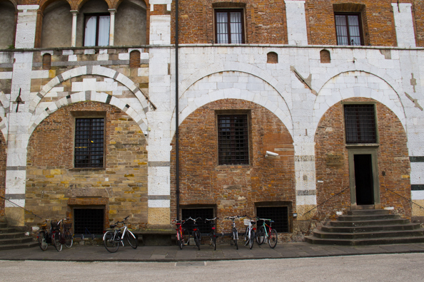Bricked in arches where the money lenders used to ply their trade in Lucca, Tuscany in Italy