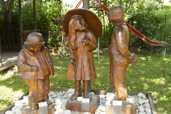 Carved figures in a playground in Praso in Trentino a region of Italy