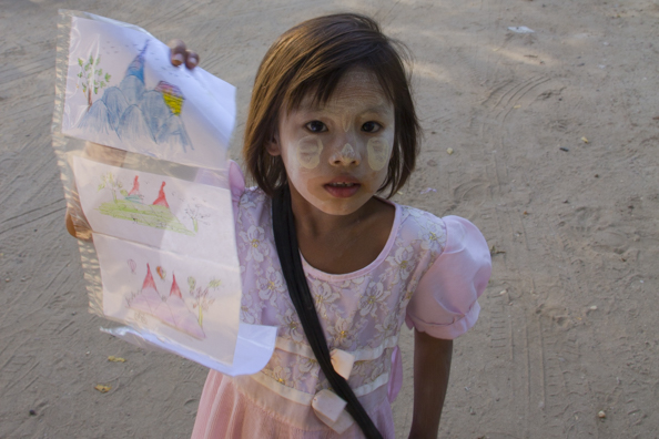 Children selling drawings in Bagan Myanmar
