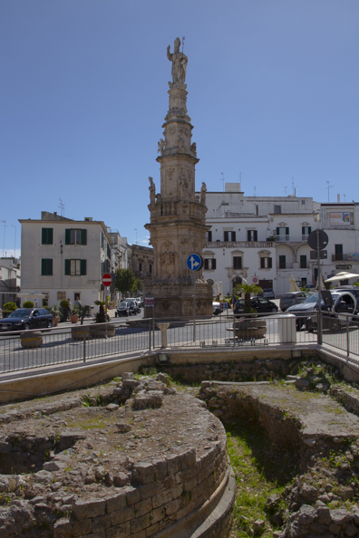 Column of Sant'Oronzo in front of the excavations in Piazza della Libertà in Ostuni, Puglia, Italy