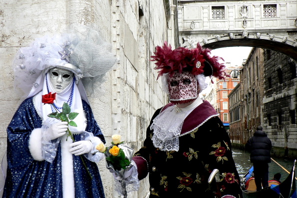 Masqueraders in front of the Bridge of Sighs in Venice