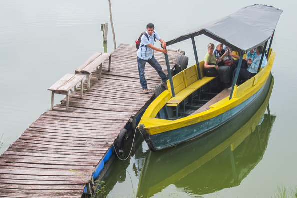Roel shepherds us on to the boat to cross the lake betweenYaxhá and Topoxté in Guatemala