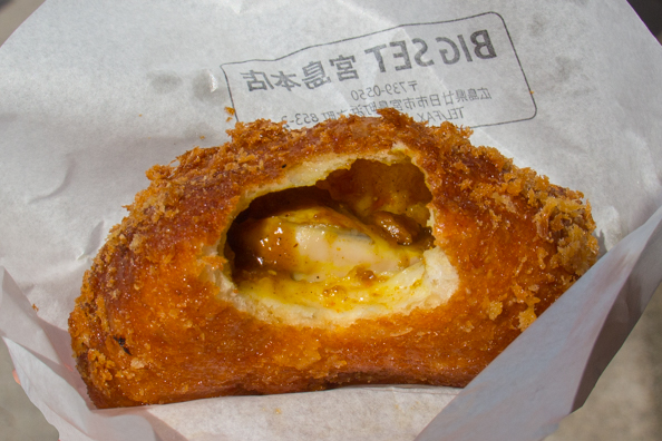 Curry with baked oysters in a baked bun from Miyajima Island in Japan