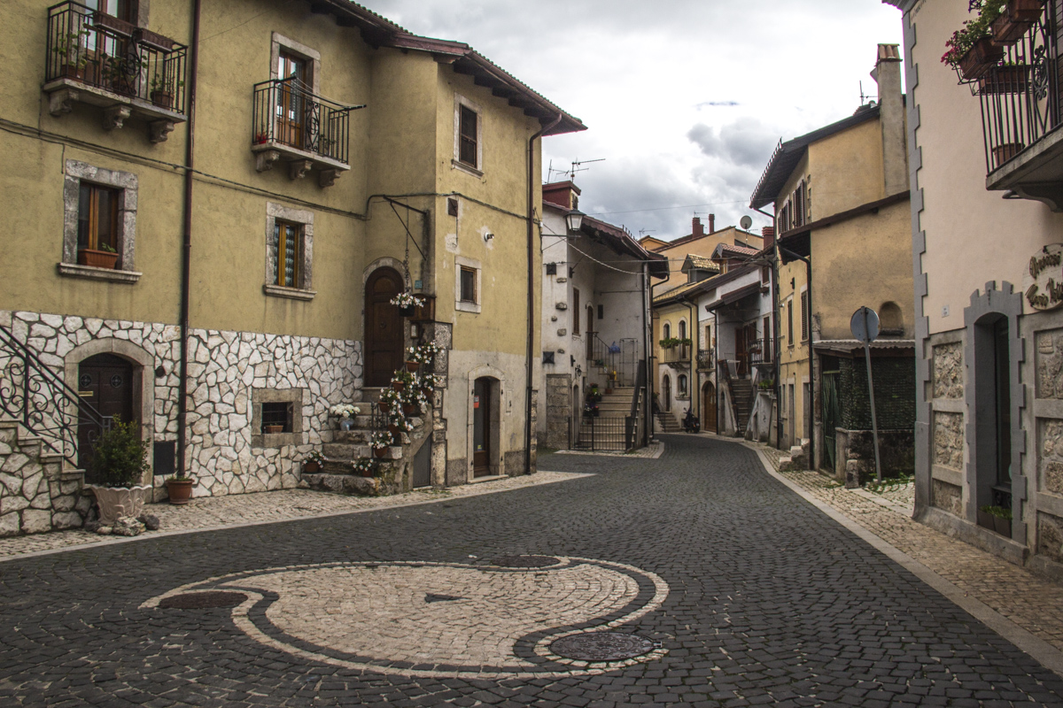 Design made from white river stones in a street in Pescasseroli, Abruzzo, italy   9909