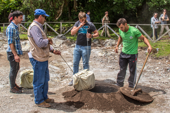 Digging up a Cozido das Furnas in the valley of Furnas on São Miguel Island in the Azores