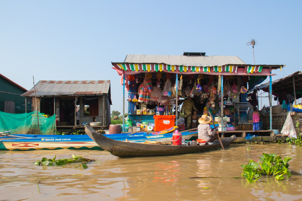 Doing the weekly shop in Chong Khneas a floating village on Tonle Sap Lake,  Cambodia