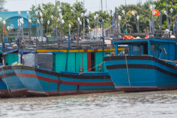 Fishing boats moored on the Tien Gang River in Vietnam