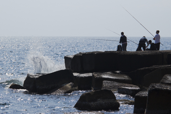 Fishing on the sea front in Monopoli, Puglia in Italy