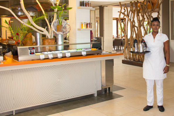 Jaya serving tea and coffee in the Show restaurant at the Tamassa hotel, Bel Ombre on Mauritius