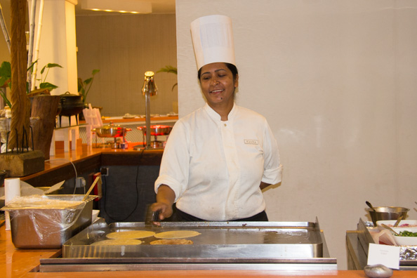 Kavita cooking pancakes in the Show restaurant at the Tamassa hotel, Bel Ombre on Mauritius