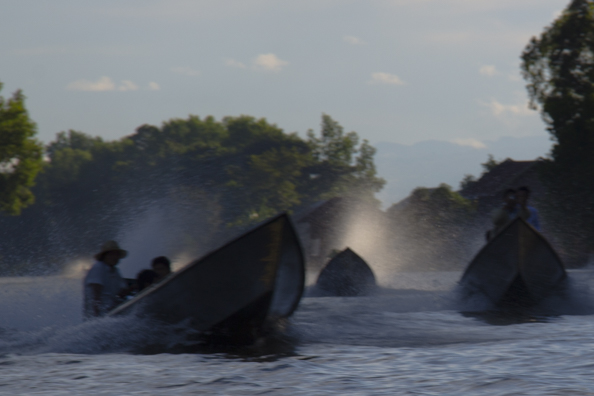 Long-tailed boats making a splash on Lake Inle in Myanmar