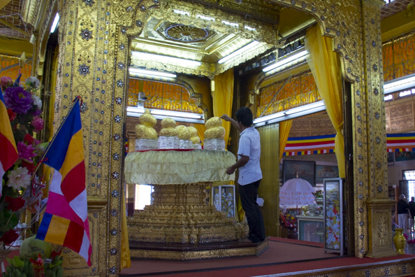 Putting gold leaf sheets on the images at Phaung-Daw-Oo-pagoda on Lake Inle