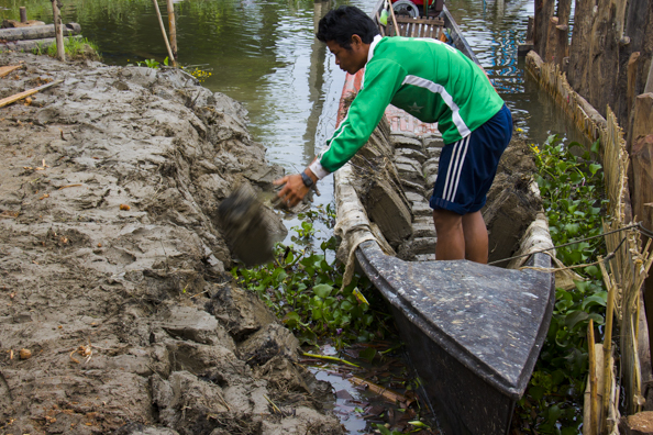 Enlarging the premises using blocks of mud on Lake Inle in Myanmar