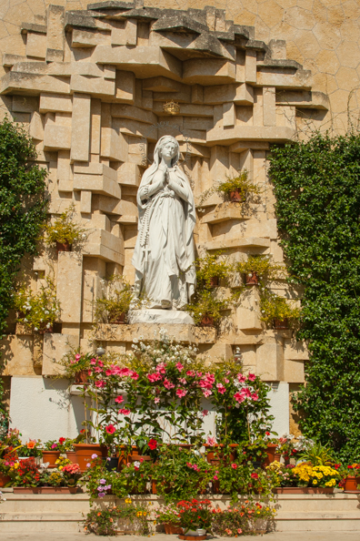 Madonna di Lourdes behind the Church of Madonna di Lourdes in Verona, Italy