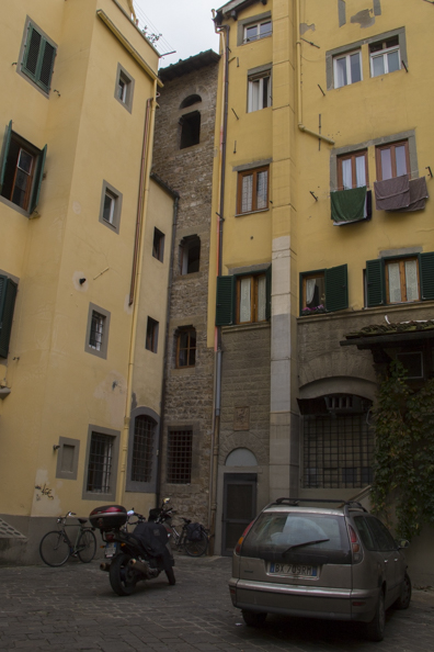 Medieval tower incorporated into the houses in Piazza Donati in Florence, Tuscany, Italy
