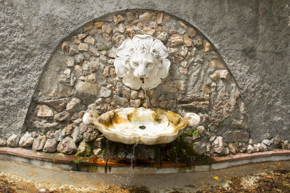 Old drinking fountain in the Orto Botanico Comunale di Lucca in Tuscany