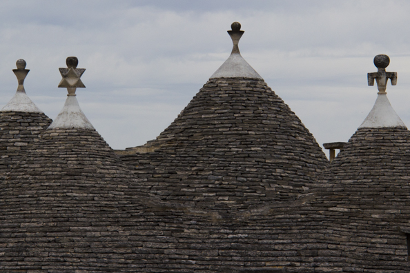 Pinnacles on the roofs of the trulli of Alberobello  in Puglia, Italy