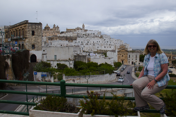 Posing in front of the old town of Ostuni, Puglia, Italy