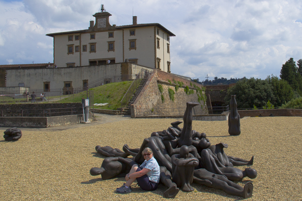 Posing with some bronze figures, work of Anthony Gormley outside Forte di Belvedere in Florence, Tuscany