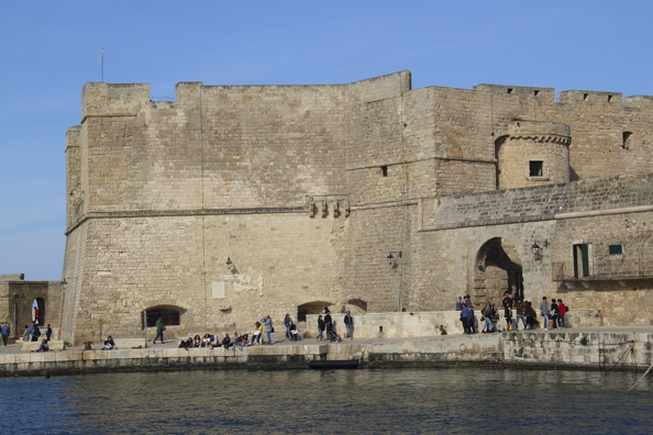 Promenading around Charles V Castle in Monopoli, Puglia in Italy