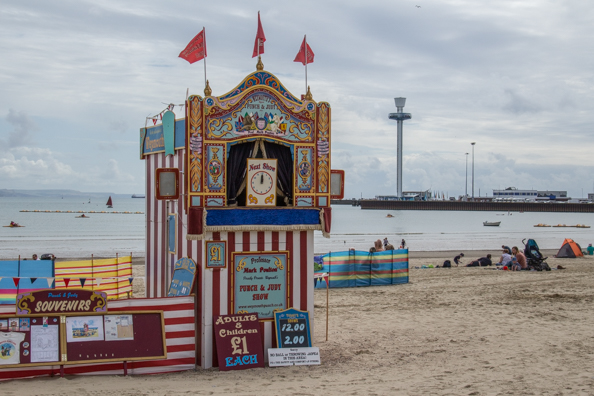 Punch and Judy on the beach at Weymouth, Dorset, UK