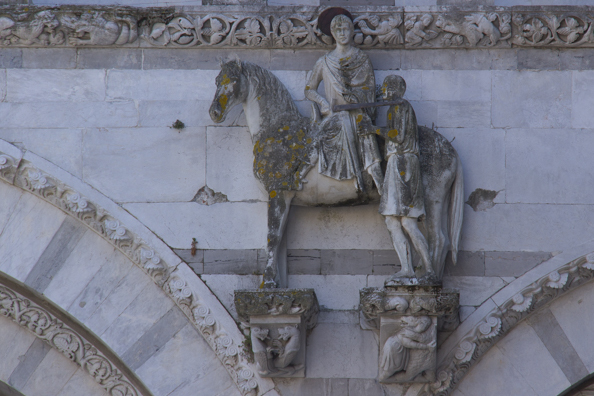 Saint Martin on his horse - detail from the facade of the Cattedrale di San Martino in Lucca, Tuscany in Italy