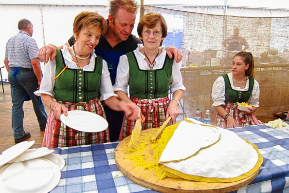Serving polenta the traditional way in Trentino, Italy