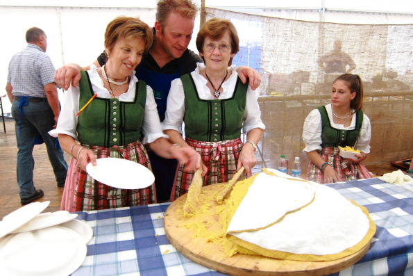 Serving polenta at a large gathering in Pinzolo