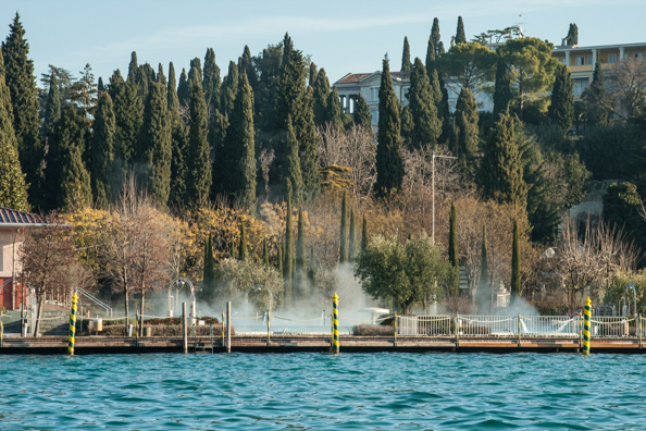 Steam rising from the Aquaria spa park in Sirmione on Lake Garda in Italy