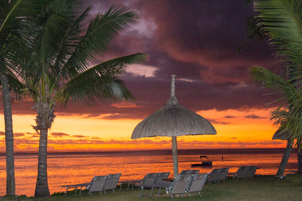 Sun setting over the beach of the Tamassa hotel in Bel Ombre on Mauritius