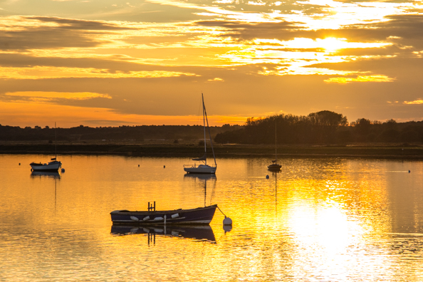 Sun setting over the River Alde in Aldeburgh in Suffolk, UK