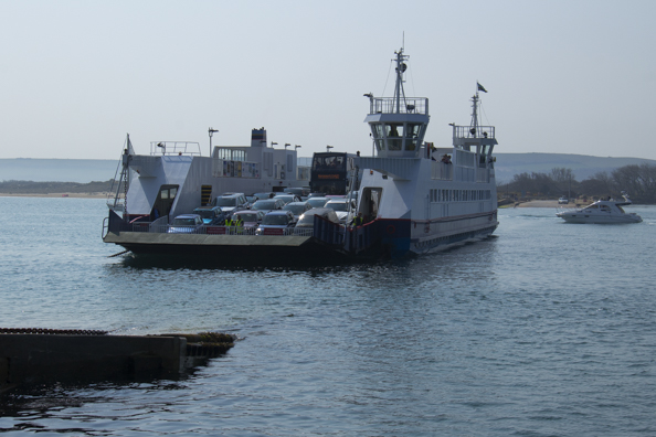 The chain ferry arrives at Sandbanks in Poole Harbour