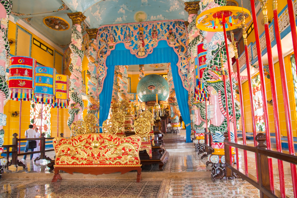The elaborate interior of the Cao Dai Temple at Tay Ninh in Vietnam