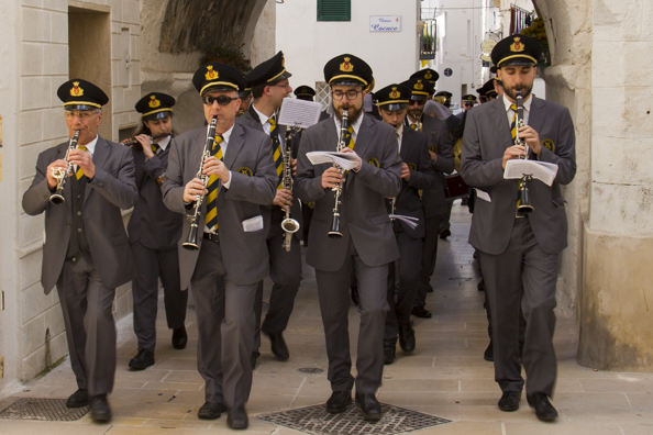 The local band parades through the old town of  Monopoli in Puglia, Italy -9996