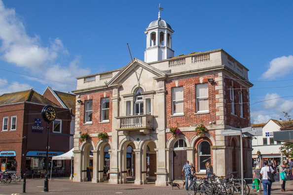 The old Town Hall in front of Saxon Square in Christchurch, Dorset UK