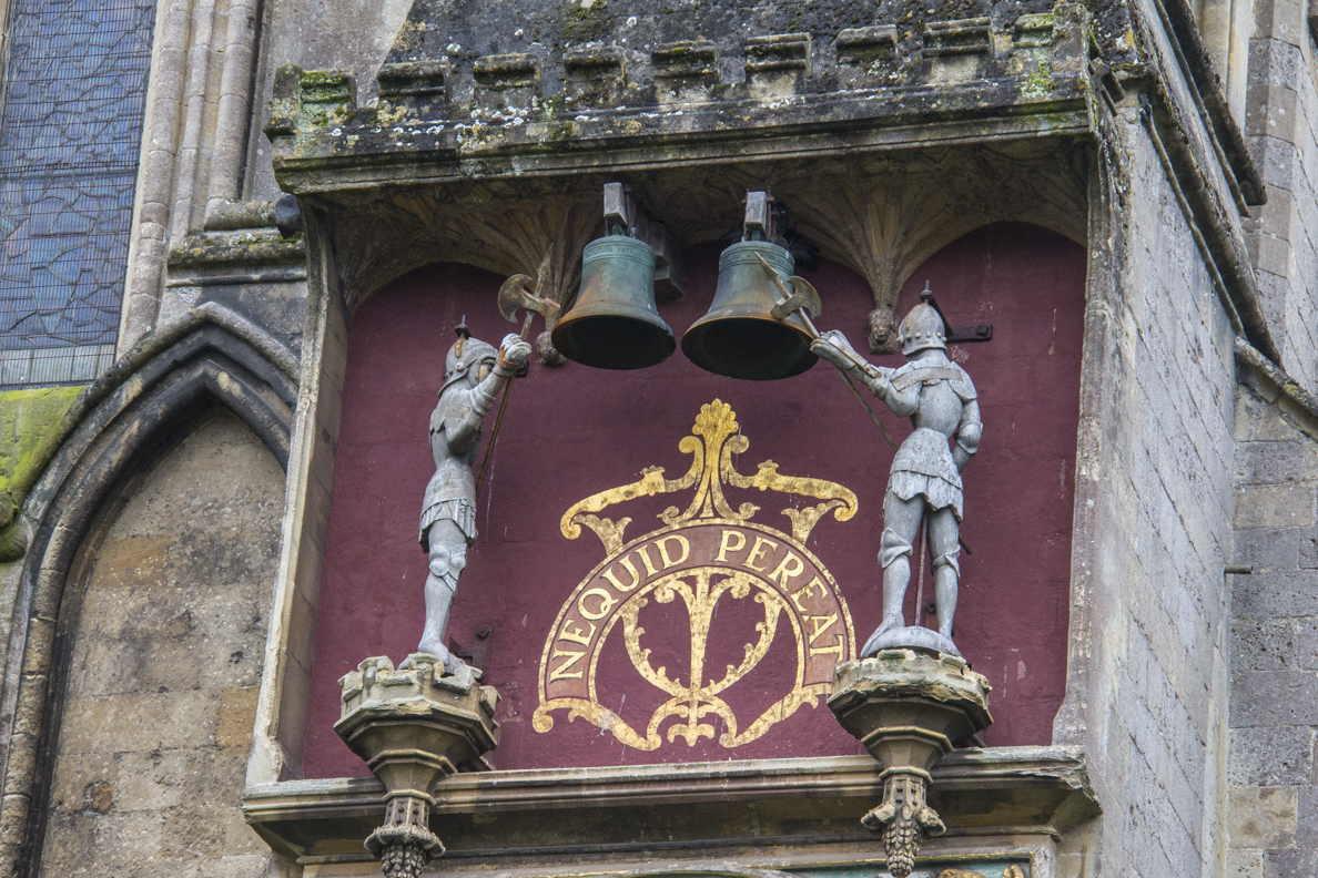 The Quarter Jacks above the external clock on the Cathedral in Wells, Somerset, England   5595