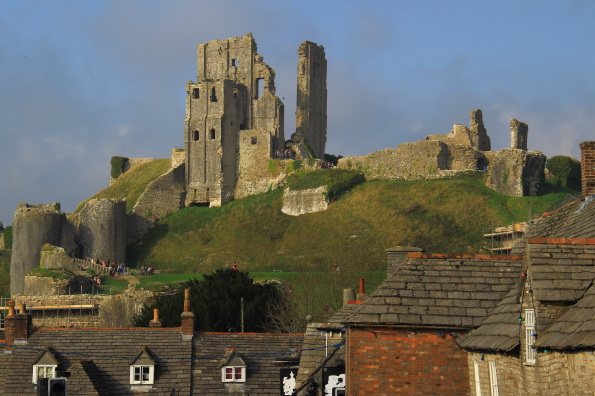 The ruins of Corfe Castle tower above the village of Corfe Castle in Dorset