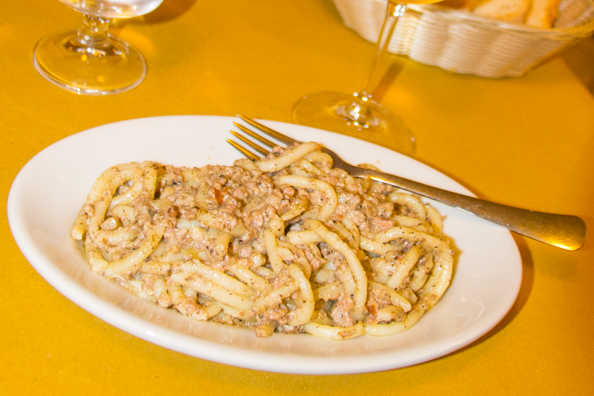Traditional pici in a creamy sausage sauce at Taverna Paradiso in San Gimignano, Tuscany Italy