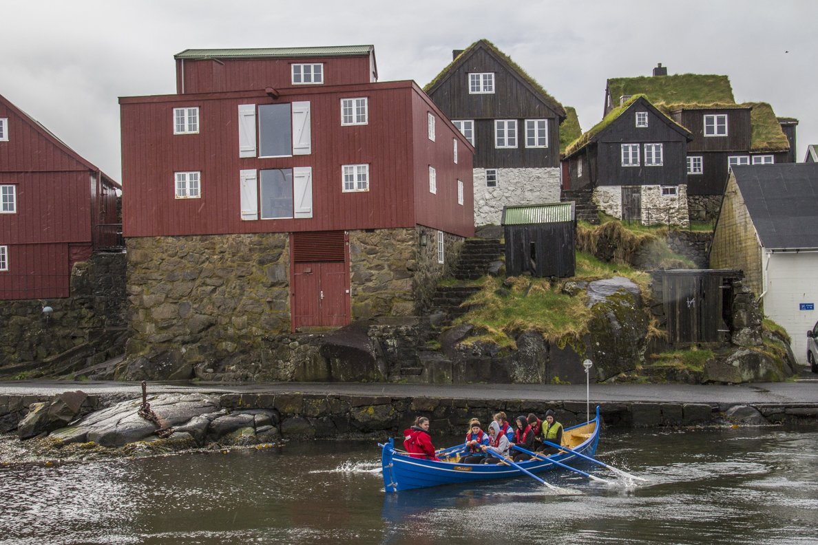 Traditional rowing boat going out to practice at Tórshavn capital of the Faroe Islands  7196