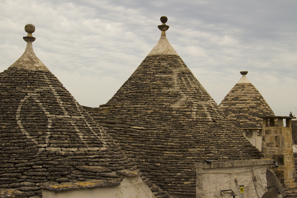 Symbols on trulli roofs in Alberobello, Puglia, Italy